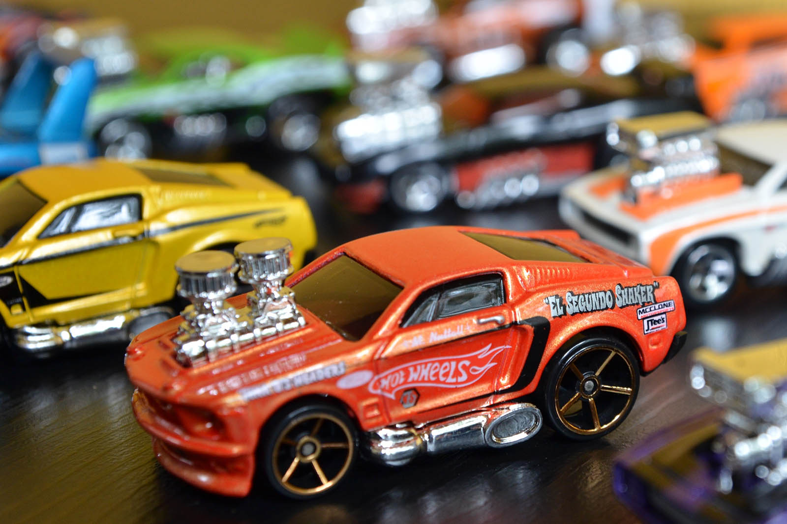 wheels cars toy collection background bokeh movie warner bros